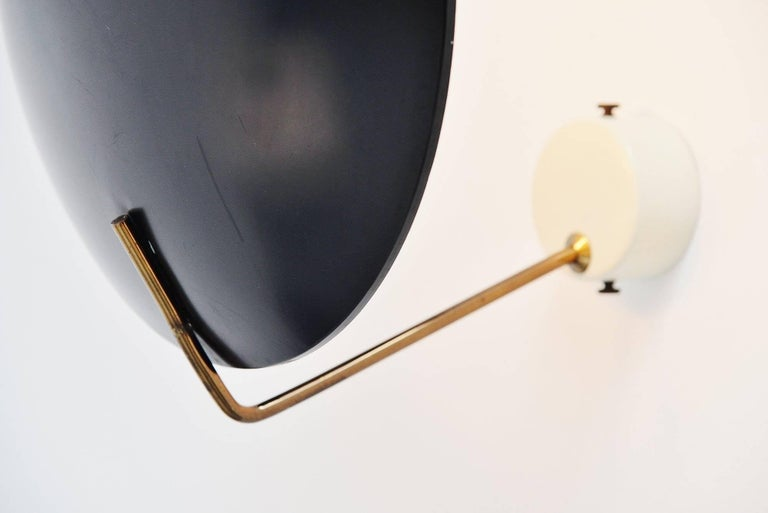 Very nice sconce / ceiling lamp model 232, designed by Bruno Gatta for Stilnovo, Italy in 1962. These lamps are often sold as Sarfatti but we have this lamp documented as a design by B. Gatta in an old Stilnovo importer catalogue. This lamp has a