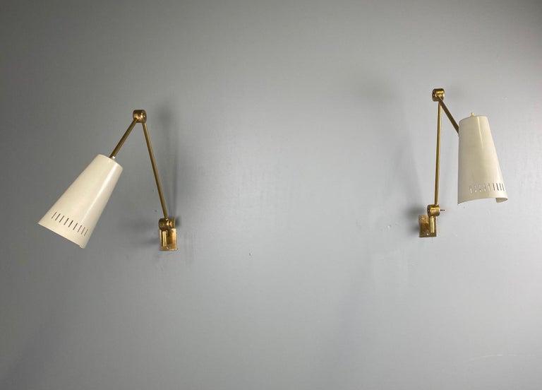 Stilnovo signed brass adjustable wall lamp, 1950s.