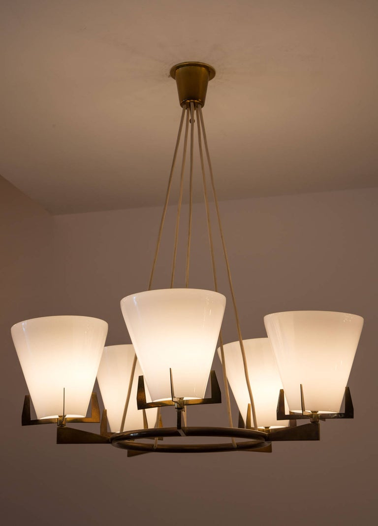 A brass and white glass chandelier.