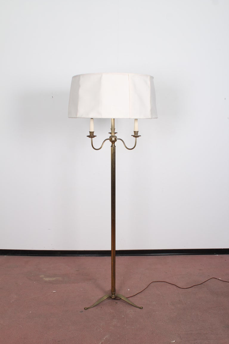 Beautiful brass floor lamp 1950s Stilnovo style with 4 lights. Wear consistent with age and use.