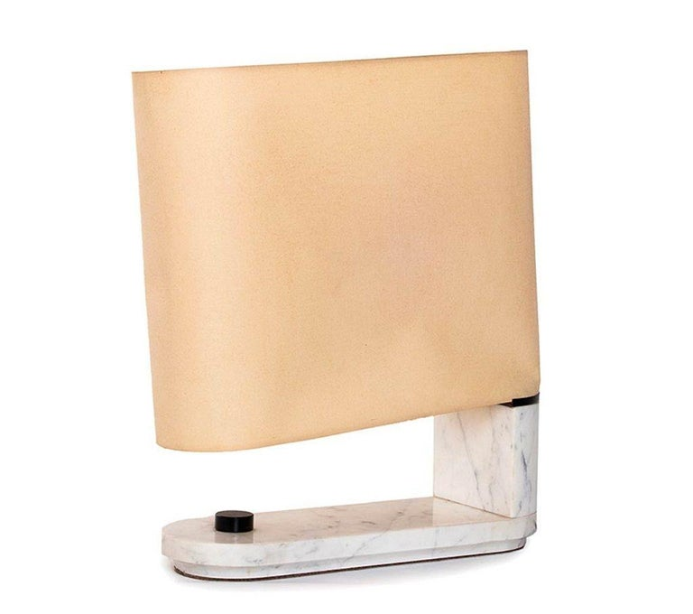 Stilnovo table lamp is an elegant design lamp designed by Danilo and Corrado Arnoldi for Stilnovo in 1970s  Table lamp with an elegant marble base and a canvas lampshade.  Dimensions: cm 52.5x 41 x 15.  In excellent conditions.  Label: