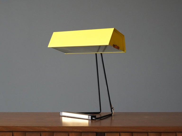 A rare Minimalist table / desk lamp. Produced by Stilnovo, Milan, Italy, 1950s. Original yellow lacquer. 
