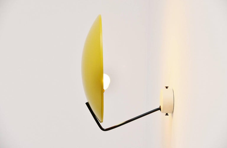 Very nice wall or ceiling lamp model 232, designed by Bruno Gatta for Stilnovo Italy in 1962. These lamps are often sold as Sarfatti but we have this lamp documented as a design by B. Gatta in an old Stilnovo importer catalogue. This lamp has a