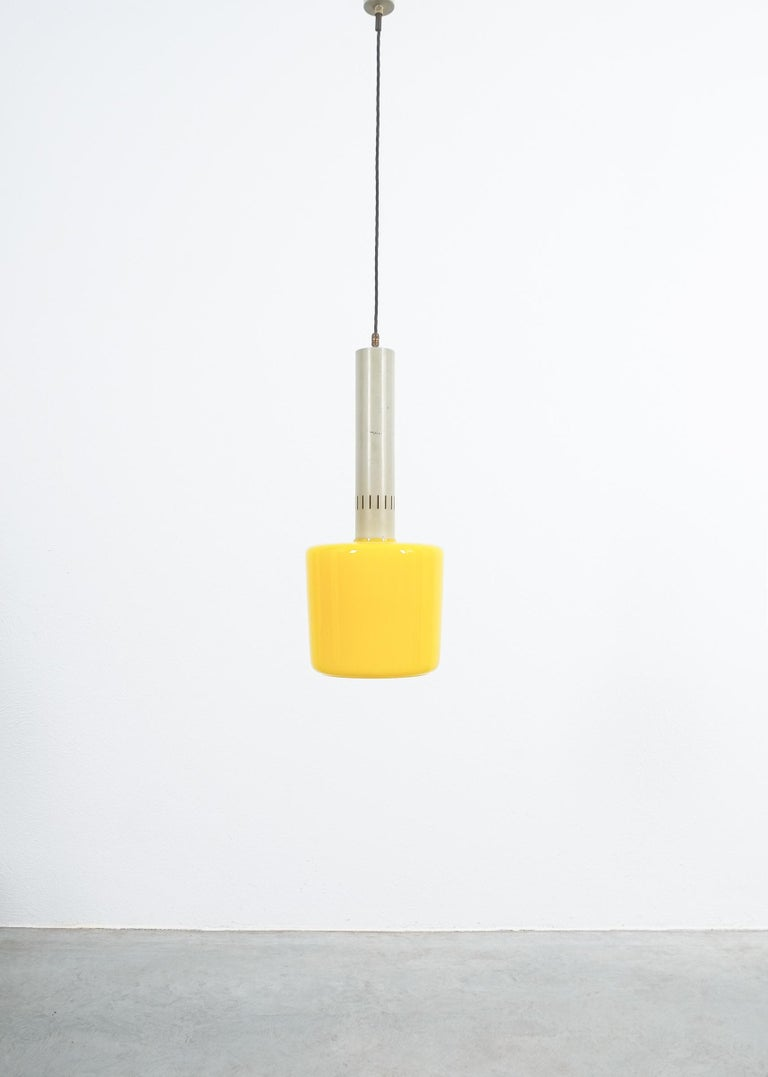 Stilnovo yellow glass pendant lamp glass, circa 1950  Beautiful Italian pendant light with a yellow glass shade and grey lacquered aluminum hardware. It's in good original condition with no chips to the glass shade, some wear to the original