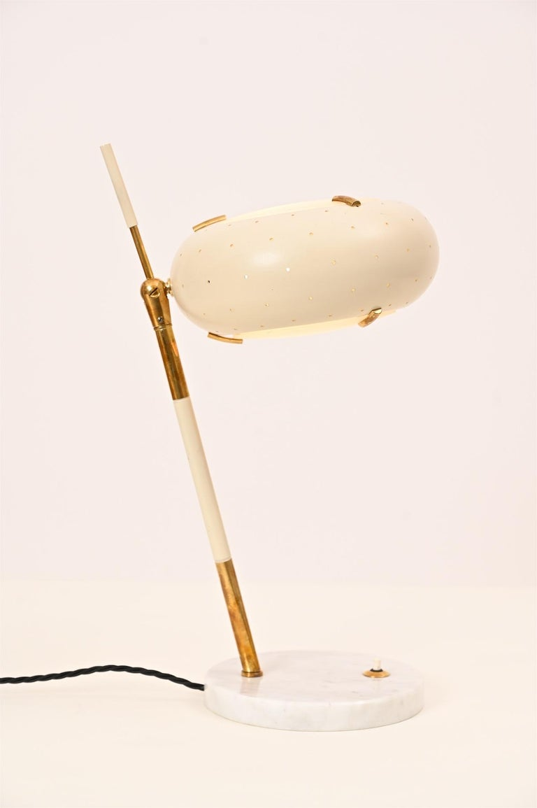 Original Stilux table light. Italy, circa 1950. Has sometimes wrongly been attributed to Arredoluce.   Painted aluminium, glass, brass and marble.