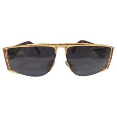 Sting black lens gold tortoise sunglasses