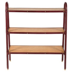 Stitched leather Bookrack by Jacques Adnet