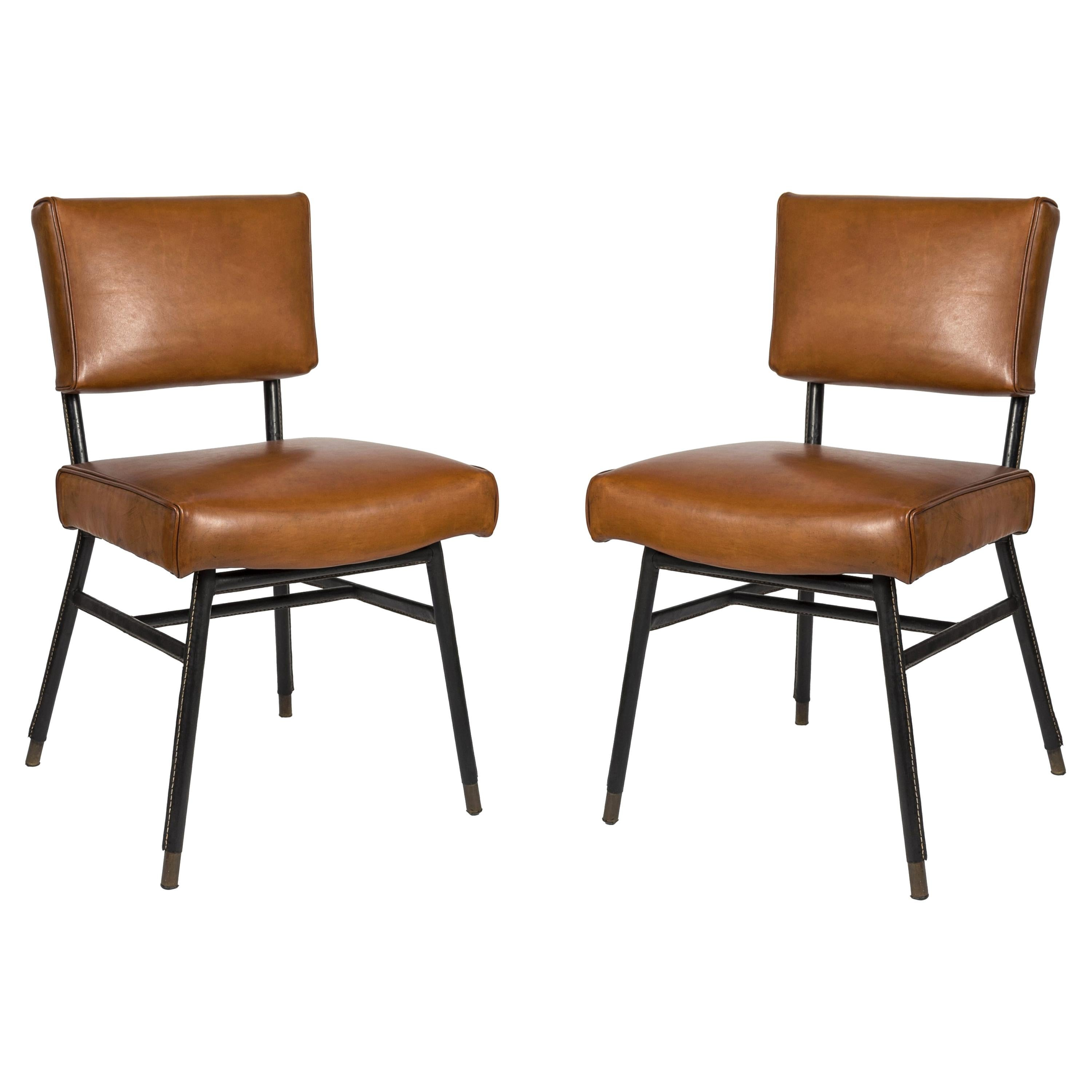Stitched Leather Pair of Chairs by Jacques Adnet