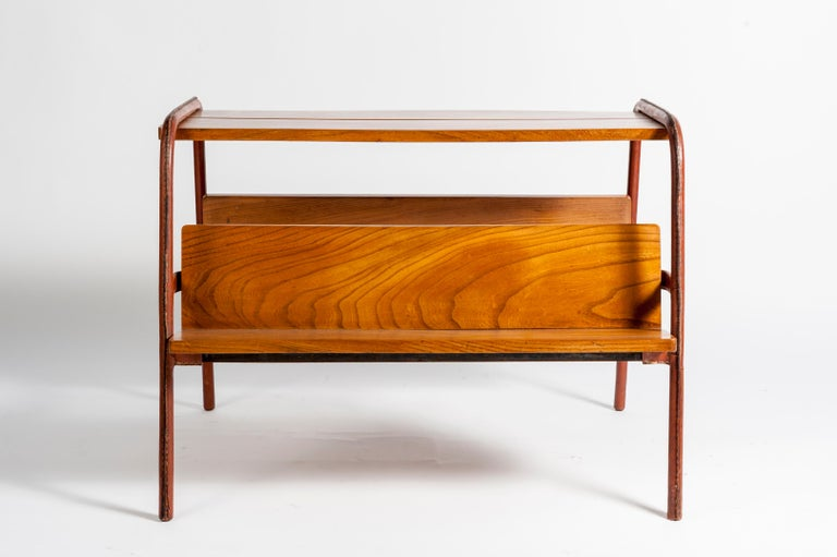 Stitched leather table or book rack table in stitched leather.