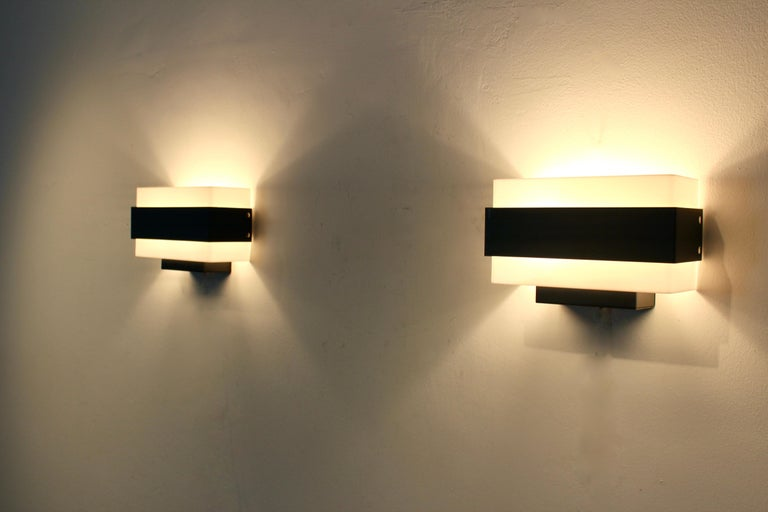 Dutch Stock of Louis Kalff Philips Wall Sconces in Black and White For Sale