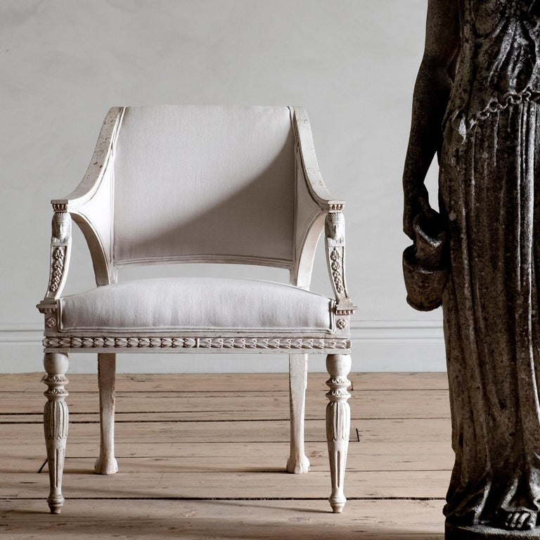 This Gustavian style armchair is inspired by one of the finest armchairs from the Gustavian period. This model was delivered to the Royal Palace in Stockholm in 1810 by Stockholm chair master Ephraim Stahl. Where they still reside today. An
