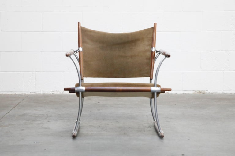 This sleek collectors item is the 'Stokke' lounge chair by Jens Harald Quistgaard for Nissen Langaa, Denmark, designed and produced in the 1960s. The 'Stokke' chair features Rosewood rails held together with chrome plated steel bars and hooks.  The