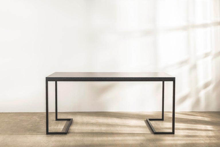 With a focus on clarity of line, form and function, this special edition desk with Indian honed granite top and angular patinated brass frame, is almost 2 metres long and stands an imposing 85cm high.  Designed by revered British architectural