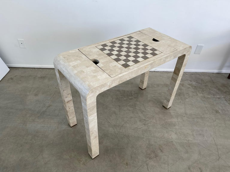 Tessellated stone console game table with reversible backgammon/ Chess board   Dimensions: H: 29.5 inches: W: 40 inches: D: 18 inches.