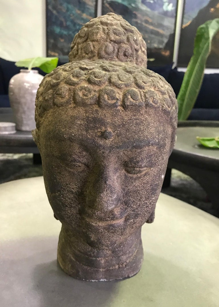 A wonderful stone-carved Buddha head with a serene contemplative joyful expression.  From a collection of Asian artifacts and Buddhist objects.  We are not sure the exact age so are listing simply as early to the mid-20th century but could be