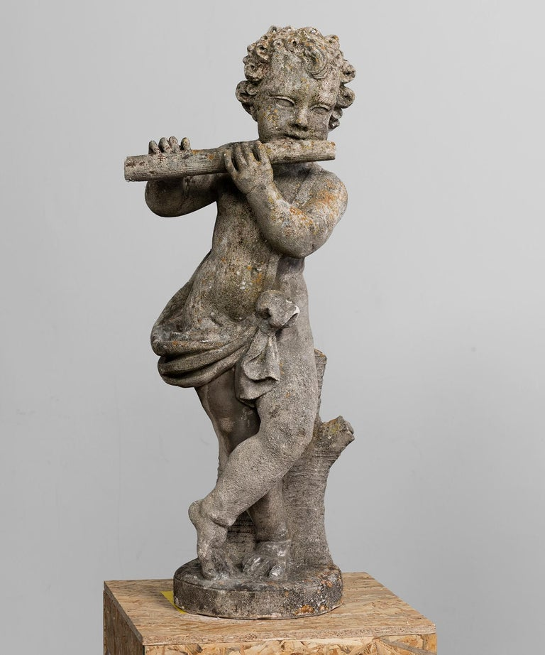 Cast stone garden statues of musical cherubs. Wonderful patina.