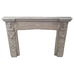Unique gothic style cast stone mantel with figurals details unusual