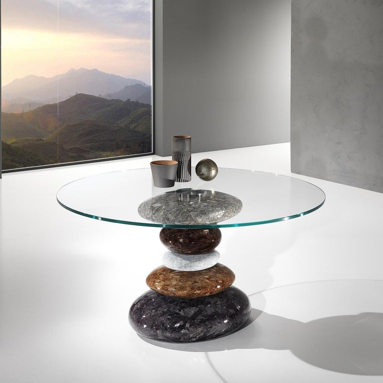 This sublime piece of decor pays tribute to Japan's artistic Suiseki tradition of water-shaped stone. The table's stunning base features 5 elements carved and finished by hand from a single block of Crystal Stone®, a unique alabaster quarried