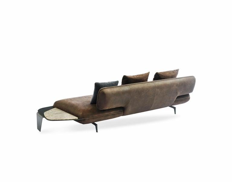 Materials: Upholstery, Calamina colored metal, travertine Dimensions: W 250 cm x D 102 cm x H 77 cm.