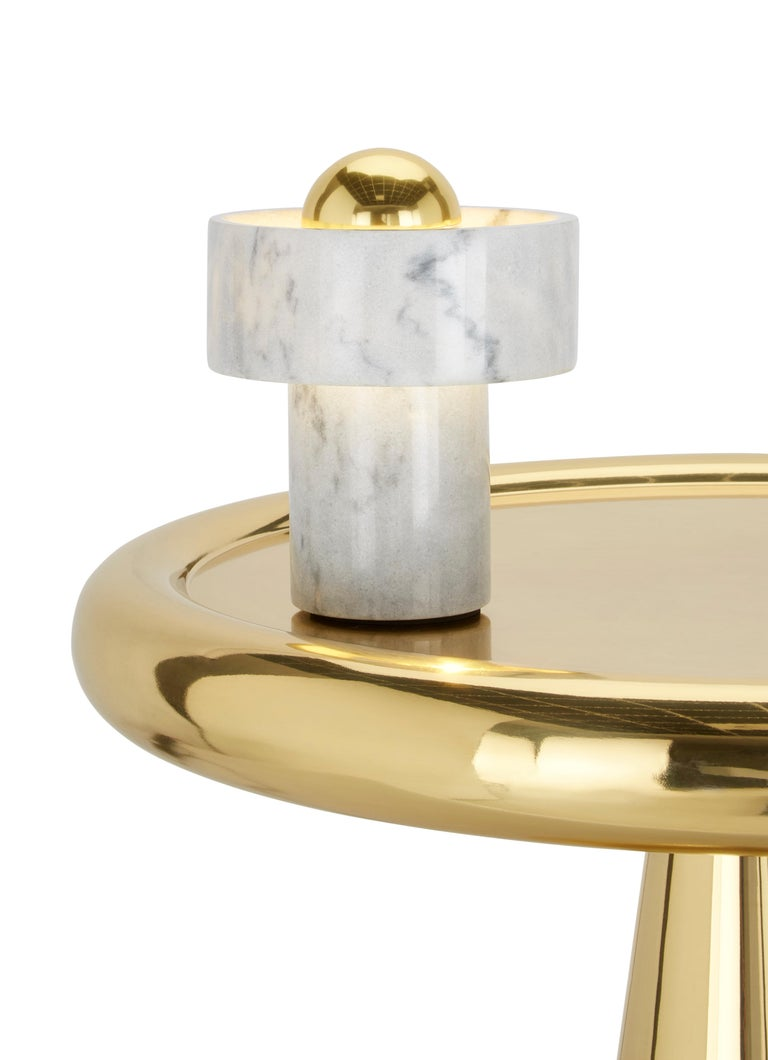 A play on our original stone spice grinder, this table light comprises a halo hollowed from white Morwad marble mounted on a tube with a central 'floating' ball in the form of a brass tipped bulb. The stone is cut to the thinnest possible depth, so