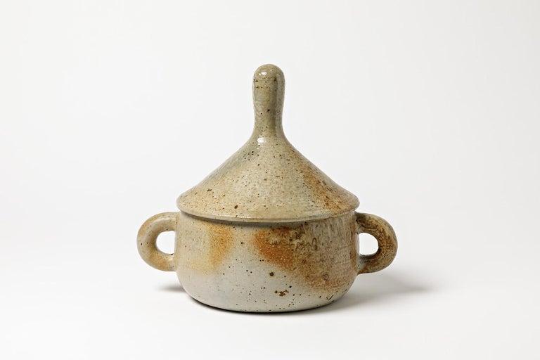 A stoneware covered-pot by Jean Lerat to La Borne. Perfect original conditions. Unique piece. Handwritten signature under the piece