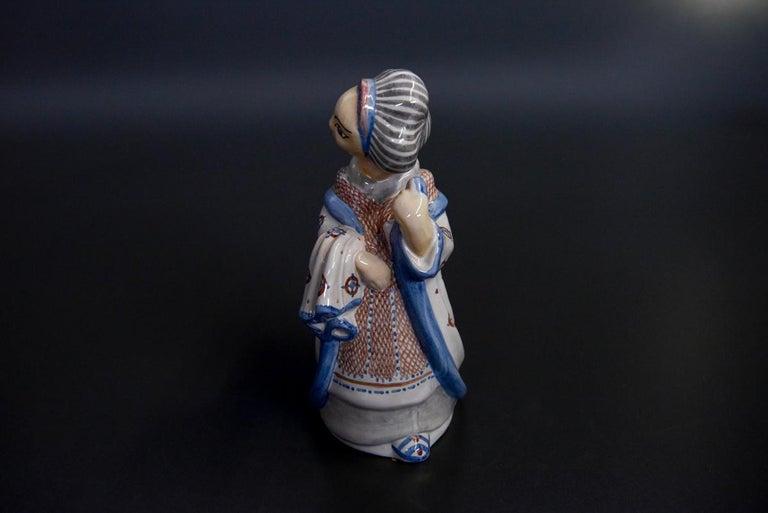 Stoneware figurine, hand painted by Danish L. Hjorth manufactory.