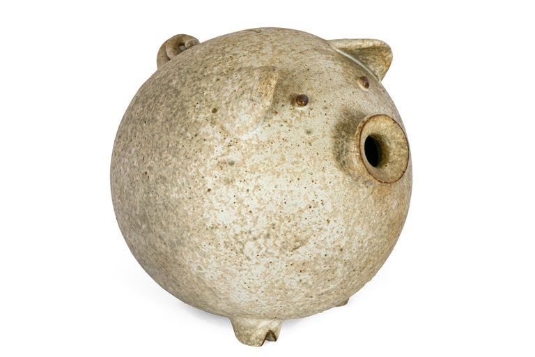 A playful and functional piece of pottery until the day you decide to empty out the coins. Until that time you will have the pleasure of enjoying a wonderfully whimsical piece of sculptural pottery.