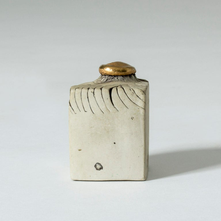 Precious little stoneware sculpture by Bengt Berglund in a suggestive shape. The top knob is coated with 24-karat gold. The perfect gold wedding gift, perhaps.