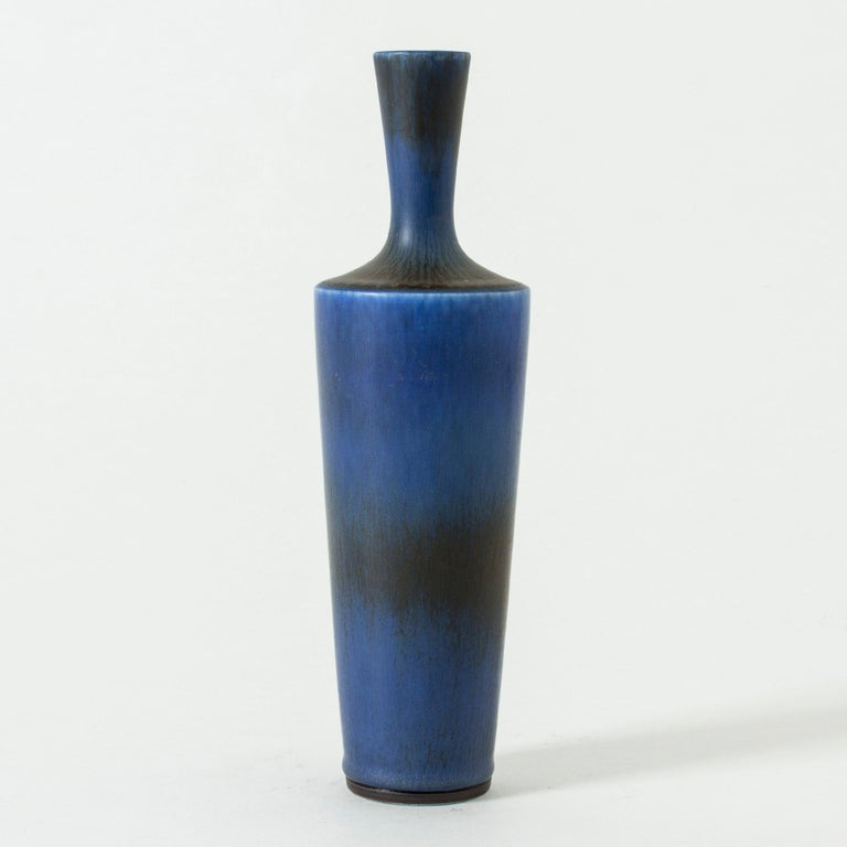 Stoneware vase by Berndt Friberg, in a stately shape with a sharp finish to the body where it transitions to the nozzle. Rich blue hare's fur glaze.