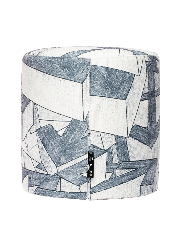 Upholstered stool in Arrow pattern printed fabric, following same wallpaper pattern. Holed Black leather label on the side By Virgil Abloh Dimensions: 45 W x 45 H This item is only available to be purchased and shipped to the United States.