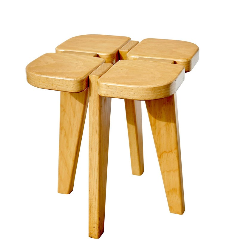 Lisa Johansson-Pape (1907-1989), best known for her serene lamp designs, approached the development of this stool almost as an architectural exercise. Made in Finland of Baltic pine, the stool's novel construction yields a simple piece of furniture