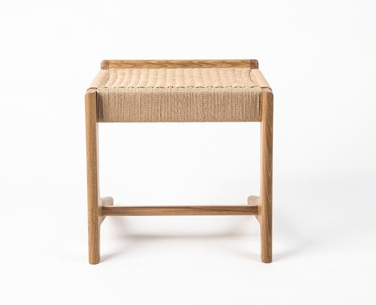 Mid Century inspired Rian Cantilever Stool made out of white oak hardwood and danish cord. Custom sizes available. Can be made with any domestic or exotic hardwood of your choosing. Danish cord comes in three colors: Kraft (Natural), white and