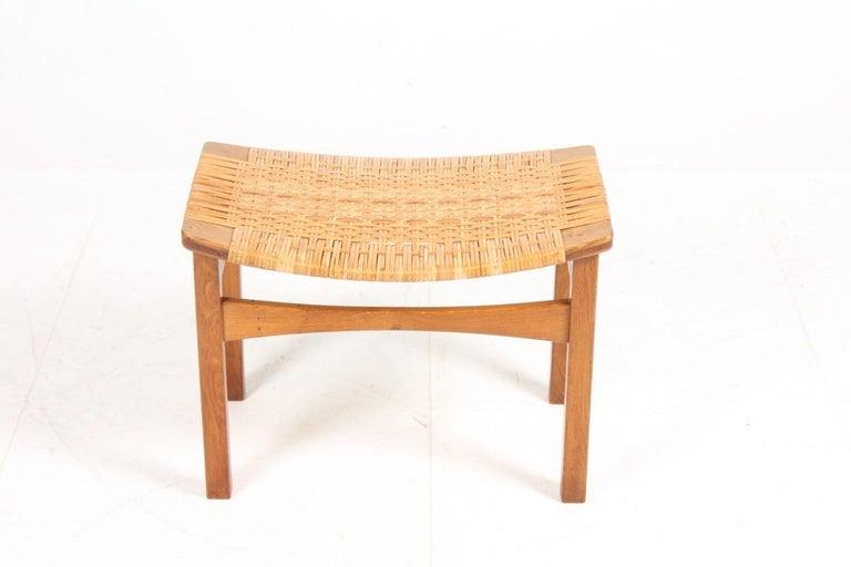 Scandinavian Modern Stool in Oak and Cane Designed by Ejnar Larsen & Madsen, Danish Midcentury For Sale