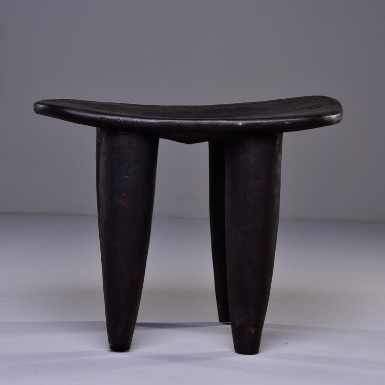 Circa 1980s stool or side table is hand carved with thick, tapered legs by Senufo people of Cote d'Ivoire.
