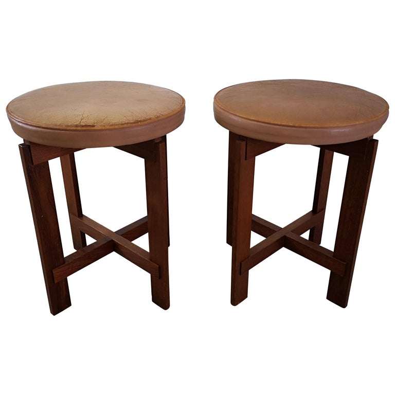 These stools in teak with seats in leather was designed by Uno & Östen Kristiansson for Luxus, Sweden. The teak part is in excellent condition. The seats has a vintage wear and one of them more wear than the other.  Good vintage condition.
