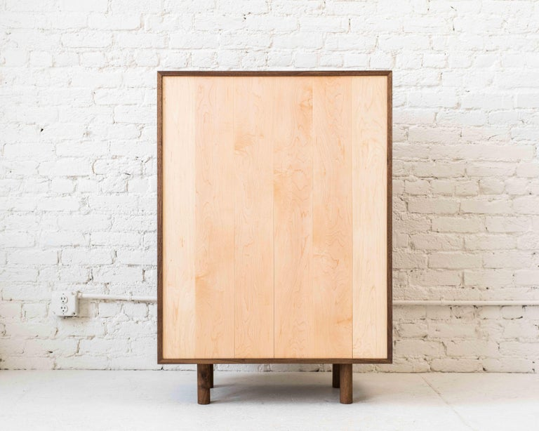Storage cupboard one by Campagna. Shown in walnut and maple. 