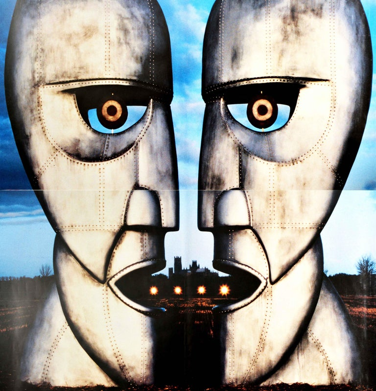 Original vintage two-sheet music advertising poster for the English rock band Pink Floyd The Division Bell new album released in 1994 featuring an image of two metal head statues facing each other forming a third face looking at the viewer against
