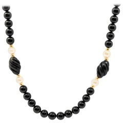 Strand of Black Onyx Beads with 14 Karat Yellow Gold and Pearl Accent Beads