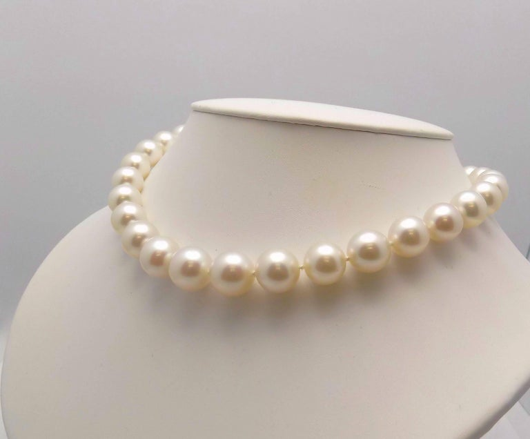 Lustrous Strand of South Sea Cultured Pearls Featuring 33 Round 11-14.2 MM Pearls,  18 Karat White Gold Diamond Pavé Clasp 1.00 Carat Total Weight SI, H, 18