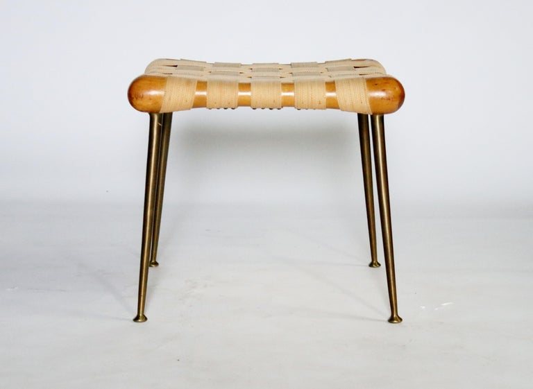 Strap bench Model #1730 in walnut and original webbing on brass tapered legs designed by T.H. Robsjohn Gibbings for Widdicomb, 1950s. Labelled.