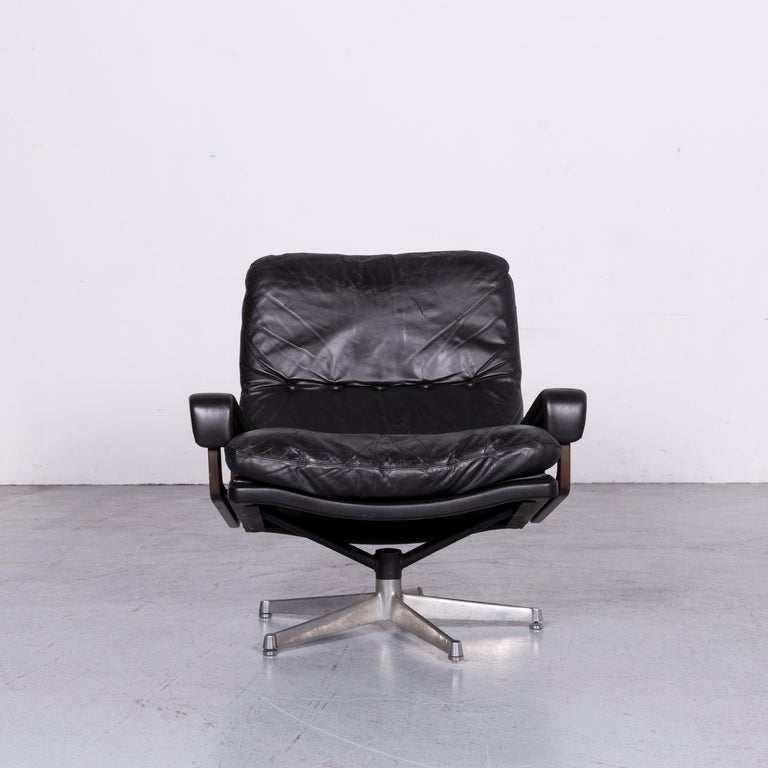 We bring to you a Strässle King designer leather armchair black chair.