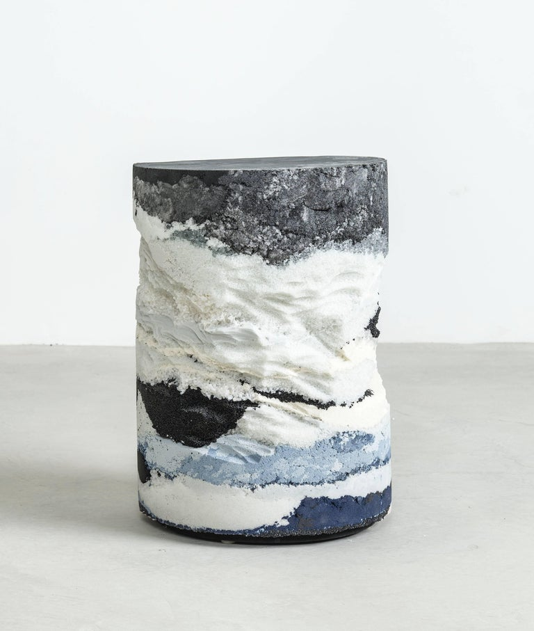 Inspired by the layers of the earth, the made-to-order drum is solid and cast from hand-dyed black silica, crushed glass, powdered glass, crystal quartz and sand. Packed in layers, the raw edges are hand-carved in natural undulations to create an