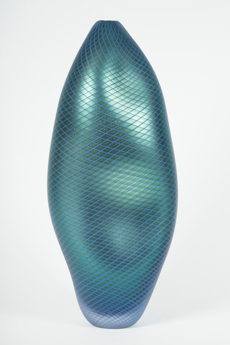 Liam Reeves employs techniques, language and traditions of Venetian glassblowing as a lens through which to explore the effect progression in technology has on the way we interact and interpret our environment.   In his own words;   'As
