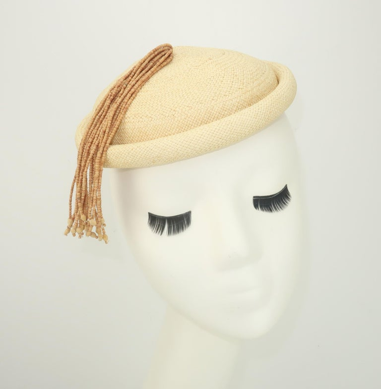 Beige Straw Fascinator Style Hat With Beaded Tassel, C.1980 For Sale