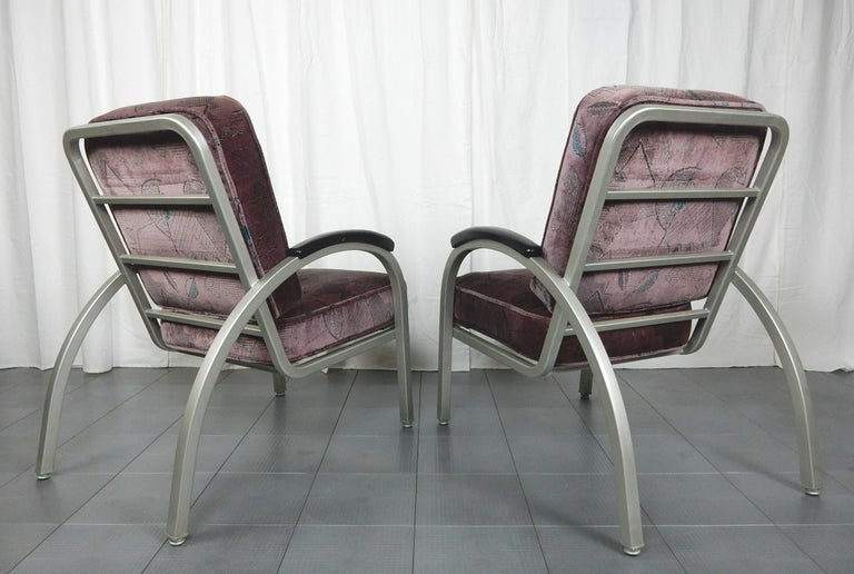 Pair of Streamline Moderne lounge chairs by Emeco circa 1940s.
