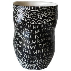 """Strength with Fragility.."" Porcelain Cup with Sgraffito Detailing"