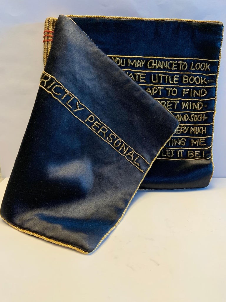 Very witty and a great size for an evening bag, these bags were retailed by high end department stores including Bergdorf Goodman in New York. The left side of the bag is the spine of the book, wrapped in gold metallic braid with red accents. The