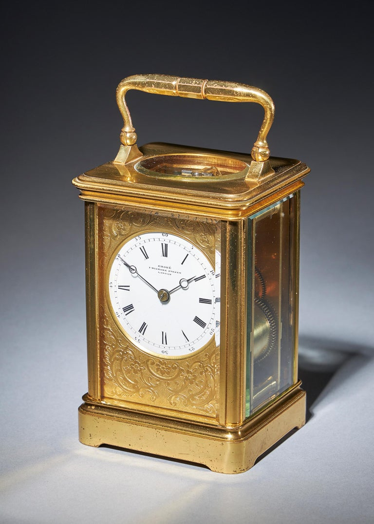 Striking carriage clock with a gilt-brass corniche case by Grohé, circa 1880.  A most attractive eight-day striking carriage clock, signed on the enamel dial GROHÉ 7 WIGMORE STREET LONDON, circa 1870. This is almost certainly a French clock made