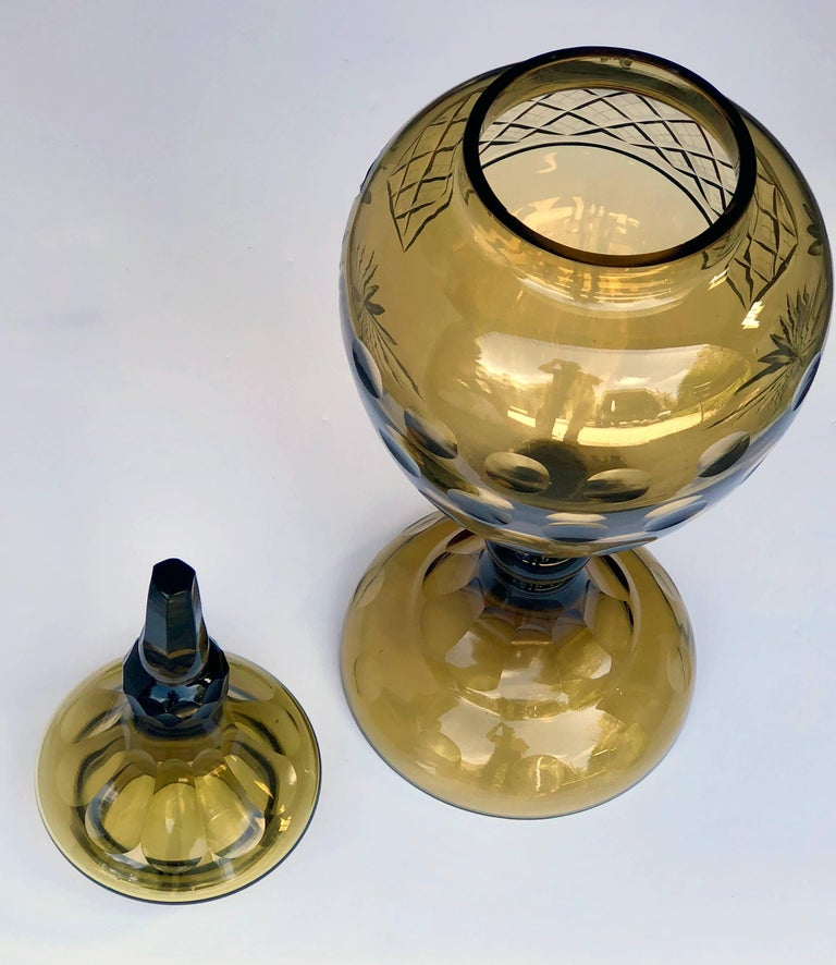 A great statement piece or centerpiece of faceted and etched glass.
