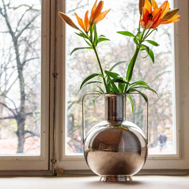 Striking Art Deco silver plated vase by C.G. Hallbergs Guldsmeds AB, later GAB, Stockholm 1938. Huge round silver plated vase with a decor of Fine lines around the body. Very good condition with age related wear and patina. Nysilver stpl M, CGH 8